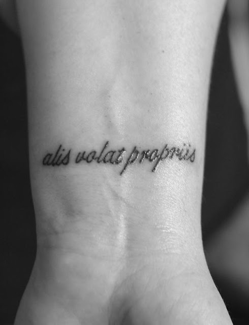 alis volat propriis she flies with her own wings tattoo on wrist