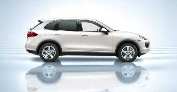 Side view of white 2011 Porsche Cayenne Hybrid