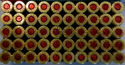 Ammunition discovered in carry-on bag.