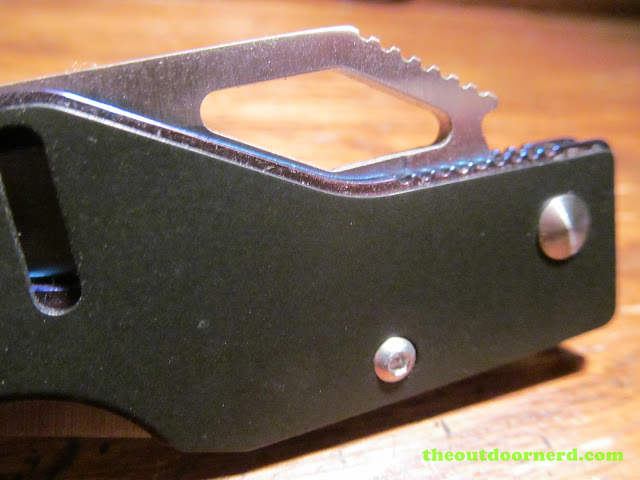 Sanrenmu B787 Pocket Knife - closeup of bottle opener