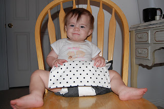 baby in fabric high chair