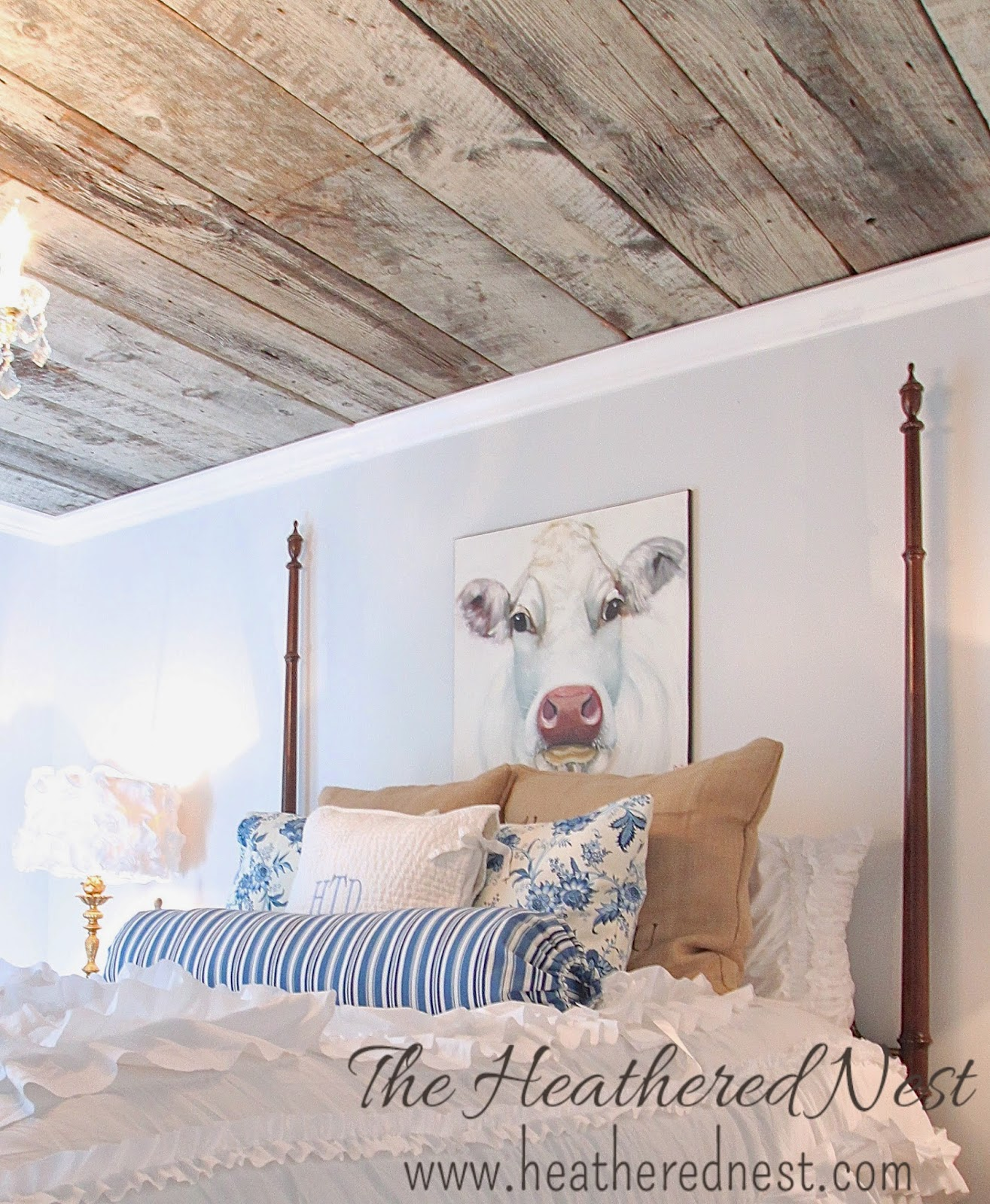 heathered nest, heathered nest guest room, heathered nest cow art, modern country bedroom, barnboard ceiling, blue and white bedroom
