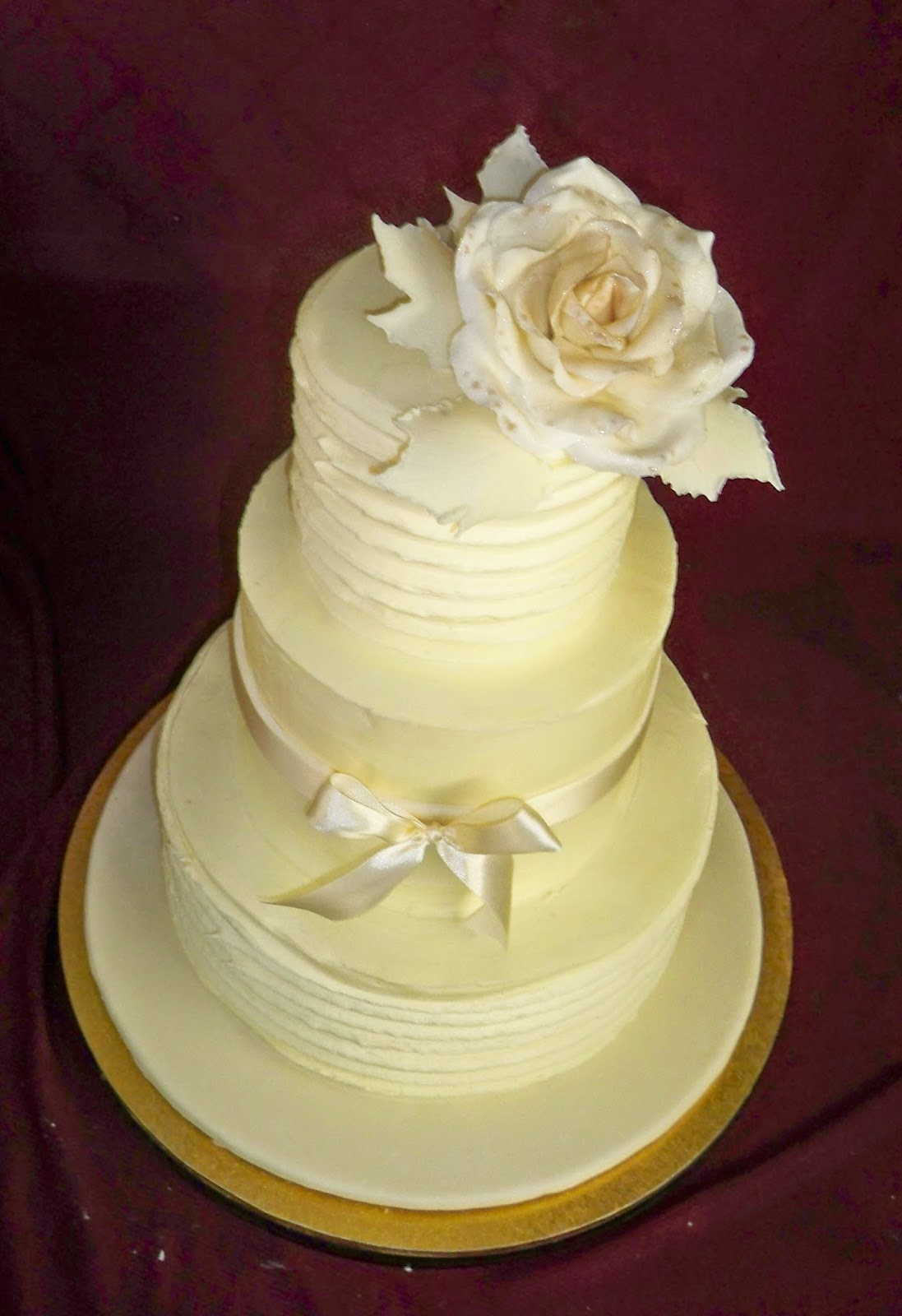 white buttercream elegant wedding cake