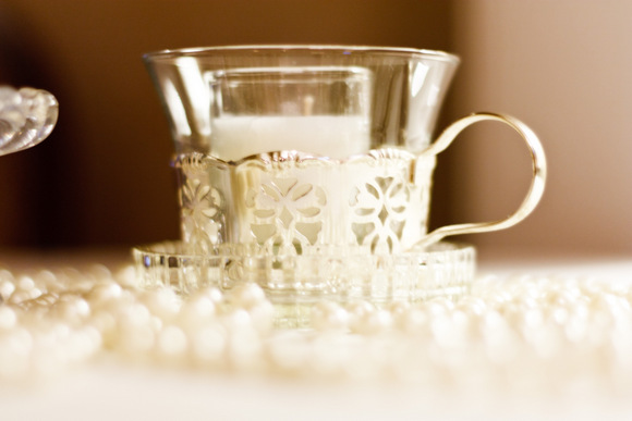 These silver detailed teacups add elegance to the wedding's table decor.