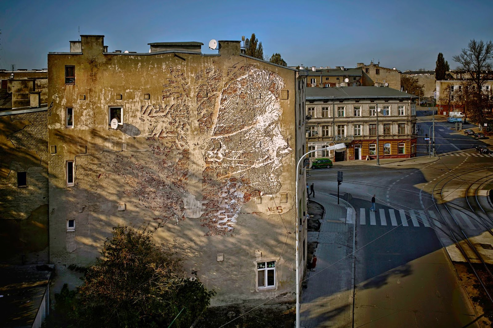 Portuguese street artist Vhils is part of this year's lineup of Urban Forms which is currently taking place on the streets of Lodz in Poland.