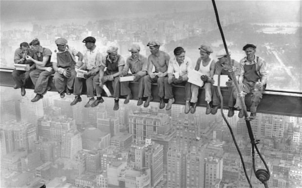 Construction Workers Sitting On Skyscraper