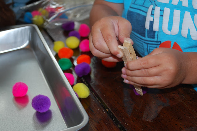 colored poms for fine motor skills
