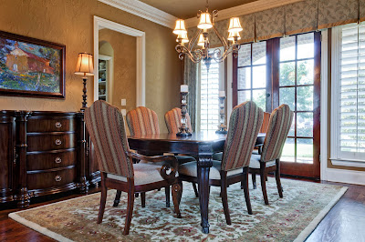 traditional and classic dining room with chandelier, carpet, and wood furniture accents