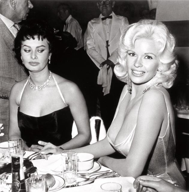 Sophia Loren casts a jealous look in the direction of Jayne Mansfield's cleavage