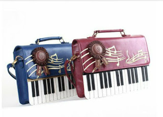 http://www.aliexpress.com/item/Charm-in-hands-2015-Rock-Style-Leather-Women-Handbag-Embroidery-Black-And-White-Piano-Keys-Famous/32323442814.html