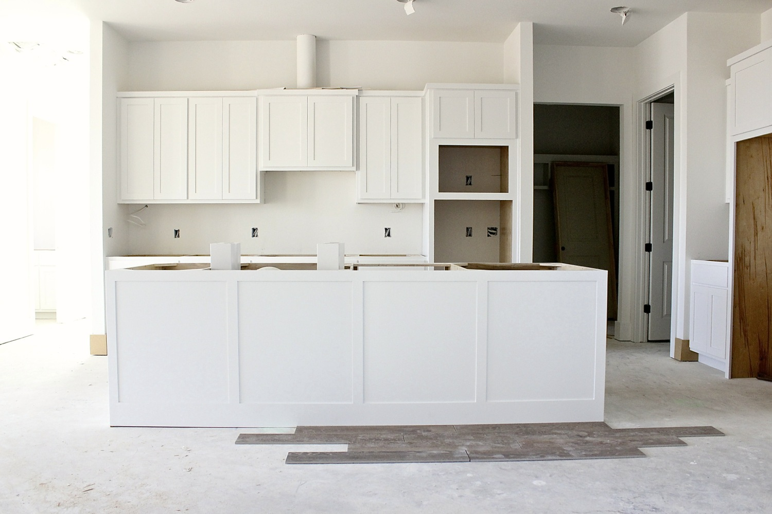The cabinets had just gone in and i love them i knew i wanted white cabinets from the very get gobut i also knew that i wanted white stone countertops