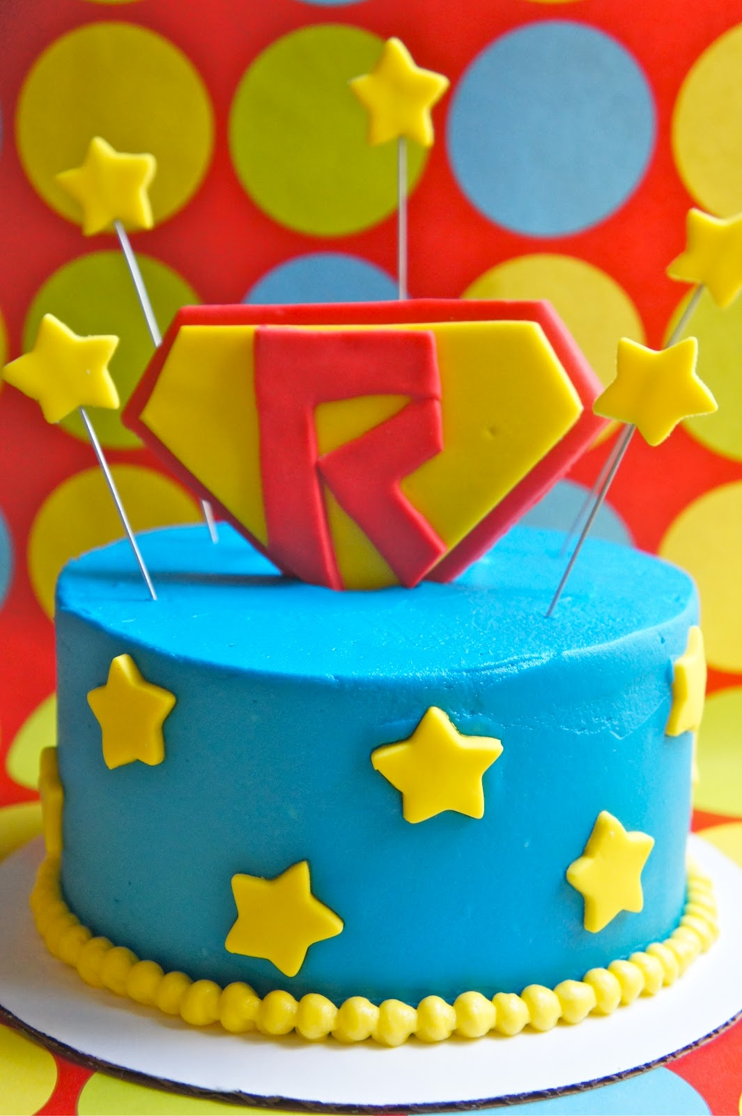 - superman cake - batman cake - joker cake - captain america cake