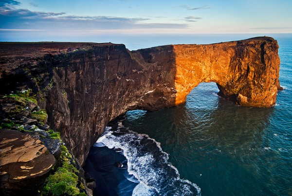 Iceland - Dyrhólaey: Spotlight on the Arch by John & Tina Reid