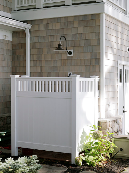 shingle house, outdoor shower, white trim, wooden enclosure