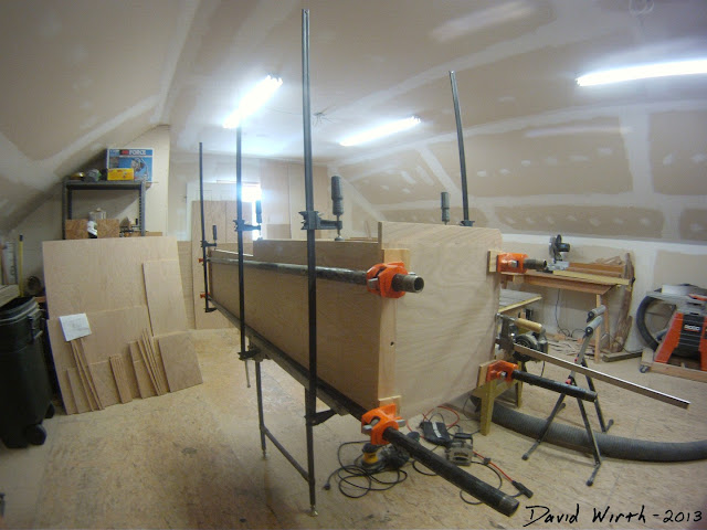 working in woodshop, glue, wood, clamp, saw, drill