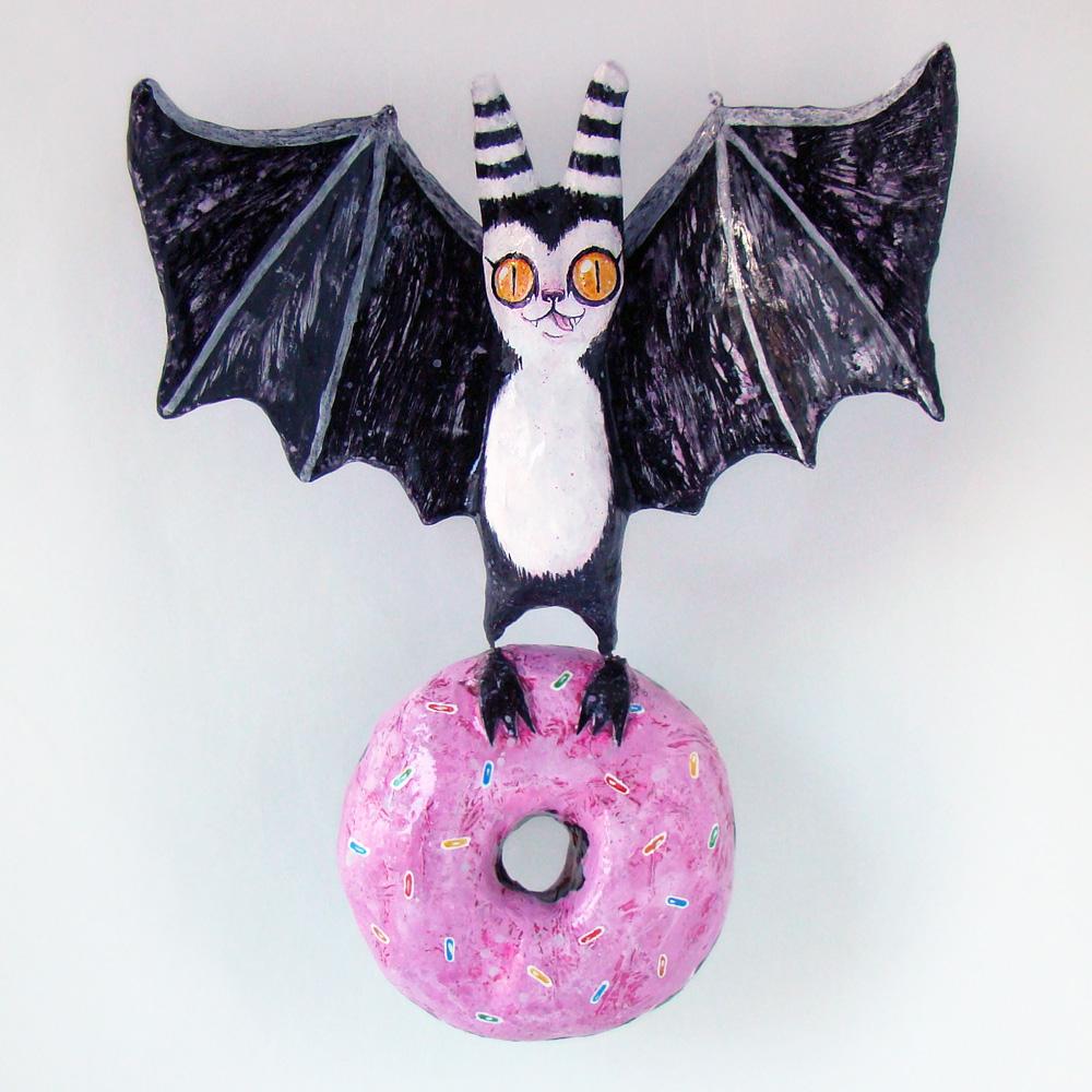 papier mache bat holding donut (blacklilypie.blogspot.com)