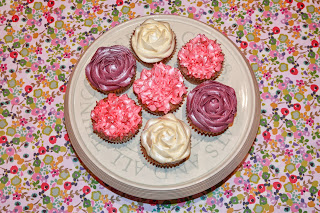 Chai latte cupcakes piped with violet, pink and cream vanilla buttercream flowers