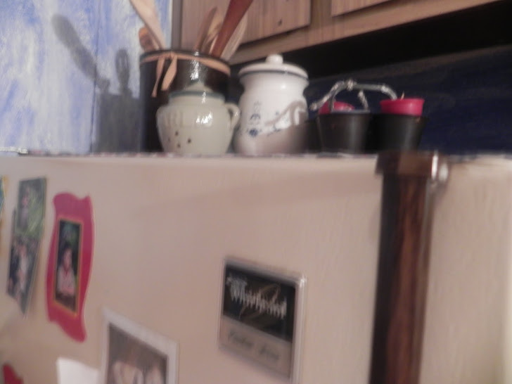 above frig, wooden spoon collection in old crock