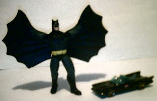 Batflapper with arms up and Hot Wheels Batmobile with gold rims