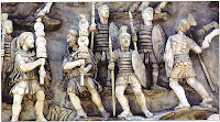 Roman soldiers carrying light spears (lancea) and shields. Detail of a relief from the Antonine Column, Rome, erected c.AD180—196 in recognition of the Roman victory in battle over a Germanic tribe.