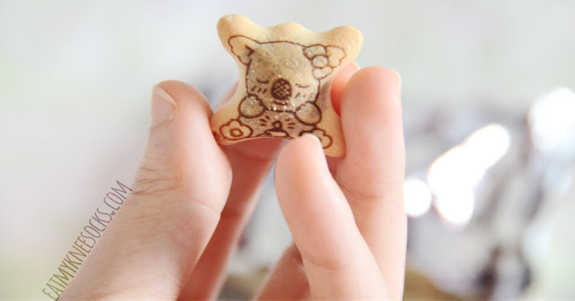 Close-up of the adorable koala-print Lotte Koala's March chocolate-filled biscuit snacks included in the June 2015 Japan Candy Box subscription.