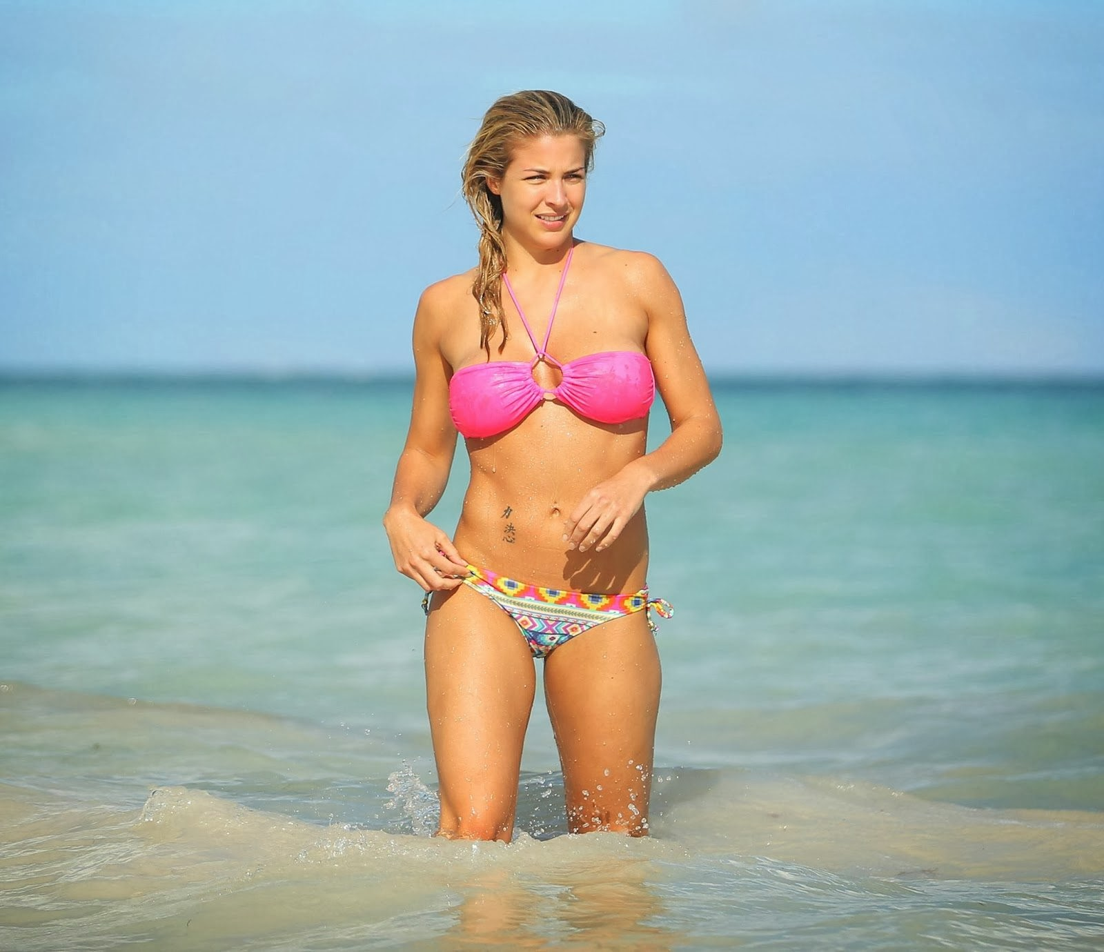 Gemma Atkinson Does Relax in a Pink Bikini on a beach in Dominican Republic