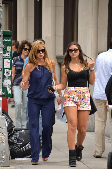 mother and daughter walking in soho