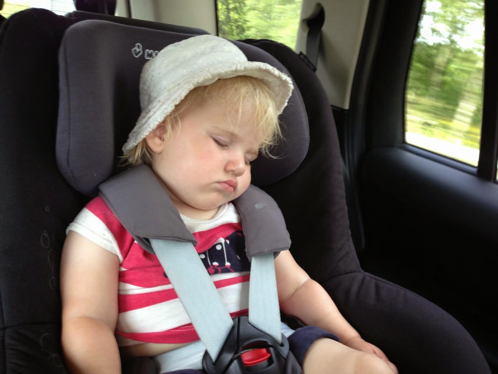Tin Box Tot sleeping in her car seat