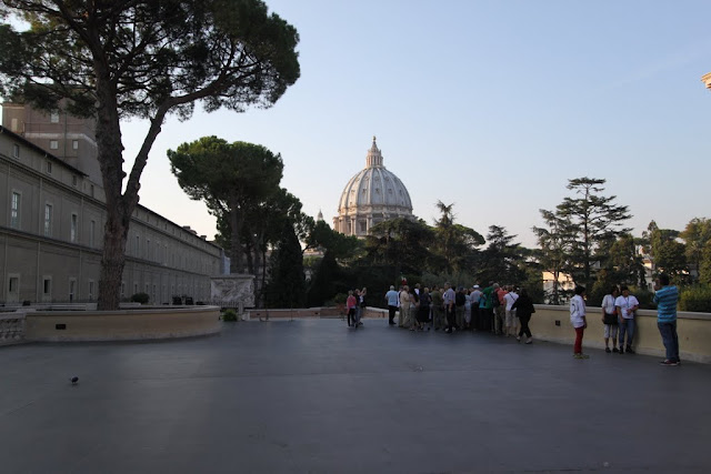 The garden at Musei Vaticani (Vatican Museum) in Rome, Italy. We can see the dome of St Peter's Basilica from here.
