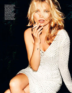 Kate Moss ina white dress smoking