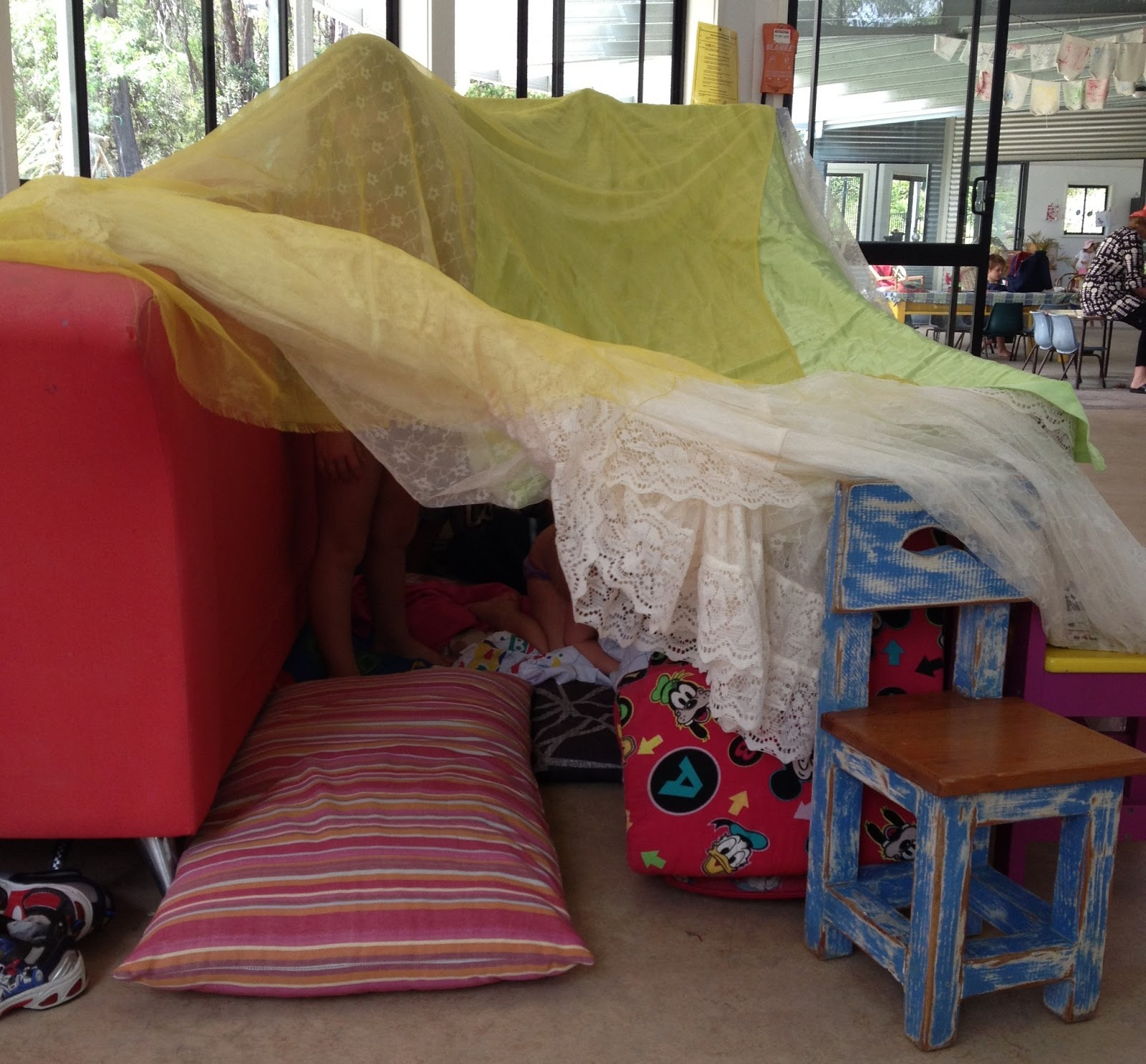 A child's version of fort, secret cubby and tunnel, via Let the children play