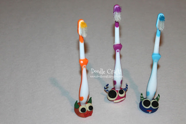 http://doodlecraft.blogspot.com/2013/02/monster-toothbrush-buddies.html