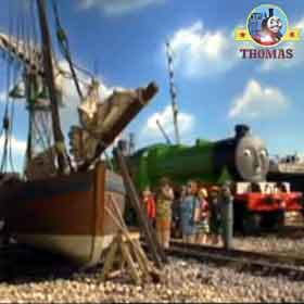Henry the railway train Brendam shipping docks holiday makers taking pictures small old fishing ship