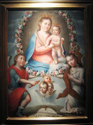 La Virgen del Refugio con el Niño rodeados de angeles.