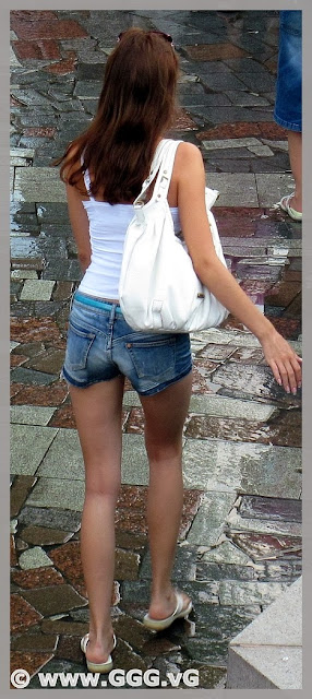 Slim girl wearing ripped denim mini shorts