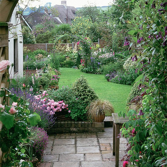 Um jardim para cuidar arbustos floridos para a primavera House and garden online