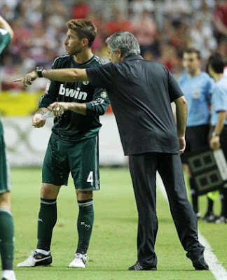 Mourinho talks to Ramos during the match against Sevilla