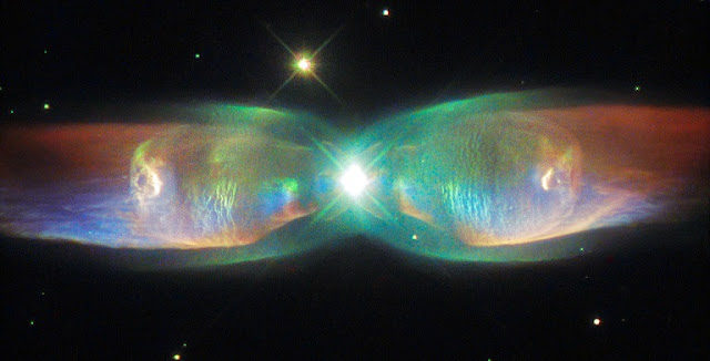 The Twin Jet Nebula, or PN M2-9, is a striking example of a bipolar planetary nebula. Bipolar planetary nebulae are formed when the central object is not a single star, but a binary system, Studies have shown that the nebula's size increases with time, and measurements of this rate of increase suggest that the stellar outburst that formed the lobes occurred just 1200 years ago. Credit: ESA/Hubble & NASA Acknowledgement: Judy Schmidt