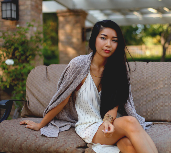 Stephanie Liu of Honey & Silk wearing Urban Outfitters dress, Left on Houston sweater, and Gorjana taner collar necklace