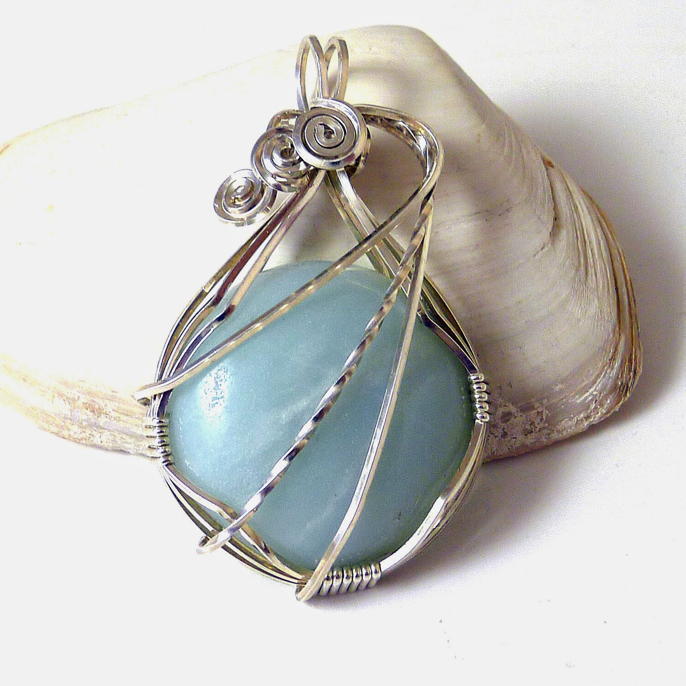 http://www.shazzabethcreations.co.nz/#!product/prd1/2462207761/amazonite-and-sterling-silver-pendant