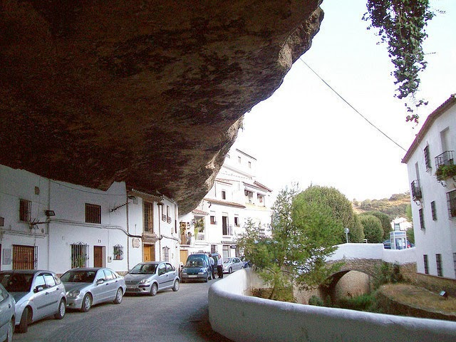 The oldest homes in the city can be found under the gorge, and new construction rests on the hillside above. - The People In This Spanish Town Are Literally Living Under A Rock.