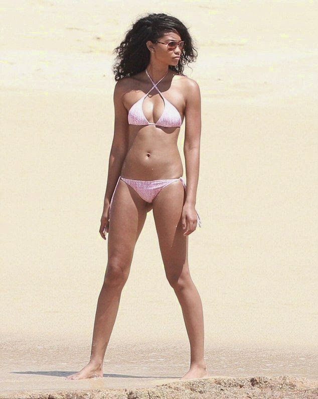 The 23-year-old displayed her slender figure in a pink bikini during a stroll at Playa Palmilla in Cabo San Lucas, Mexico on Wednesday, June 25, 2014.