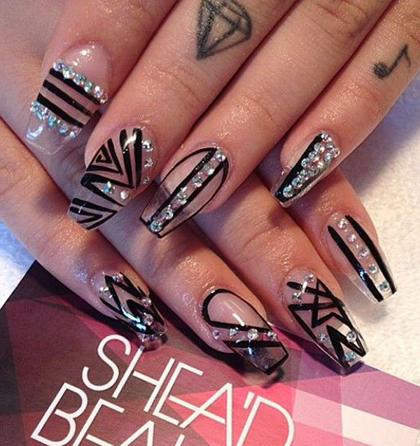 40 black nail art ideas fashion hippoo artsy looking stick on nails in black tribal polish designs the silver embellishments on top help make the nail art look very interesting prinsesfo Images