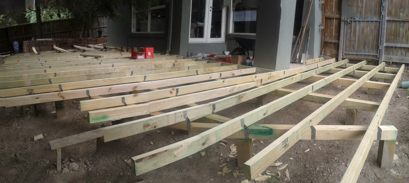 Let 39 s build a deck deck building laying in the ledger for Balcony joists