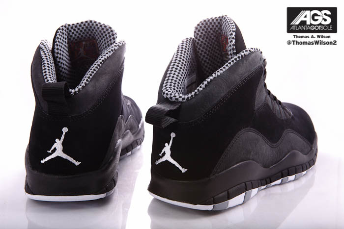 Black holds steady at the midsole, which sits atop a white and grey rubber  outsole etched with MJ\u0027s career achievements.