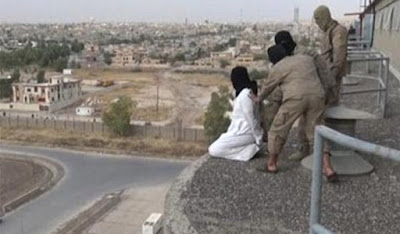 A gay man is about to be thrown off a building rooftop by ISIS fighters in Iraq in August 2015.