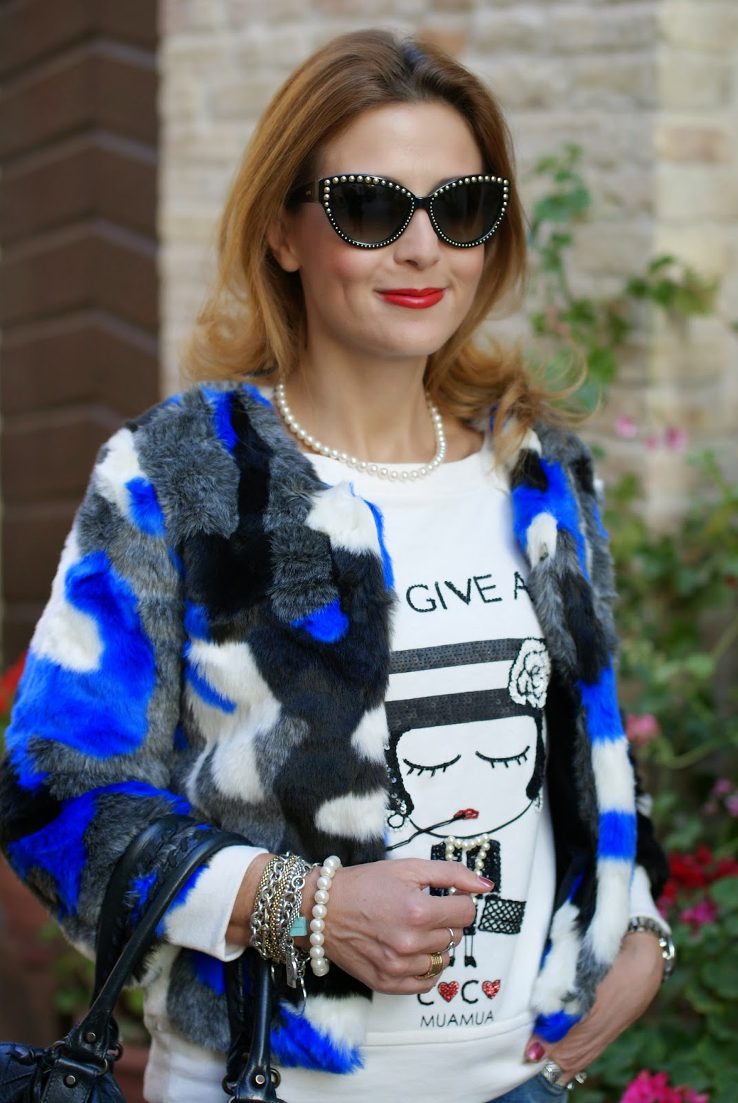 faux fur in cobalt blue, pearls necklace, Mua Mua I don't give a chic sweatshirt, Balenciaga work black, Moschino studded sunglasses, Fashion and Cookies, fashion blogger