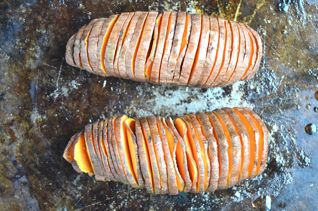 Stuffed Hasselback Sweet Potatoes- loaded with sweet apples, dried cherries, pecans, maple syrup and protein granola for breakfast or dessert! www.nutritionistreviews.com
