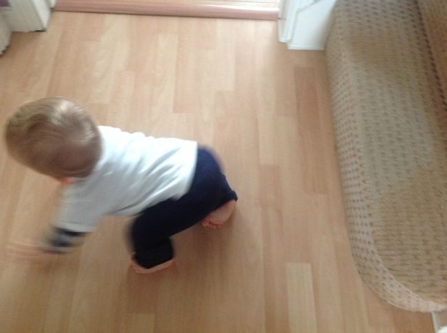 blurred baby crawling away from stairs