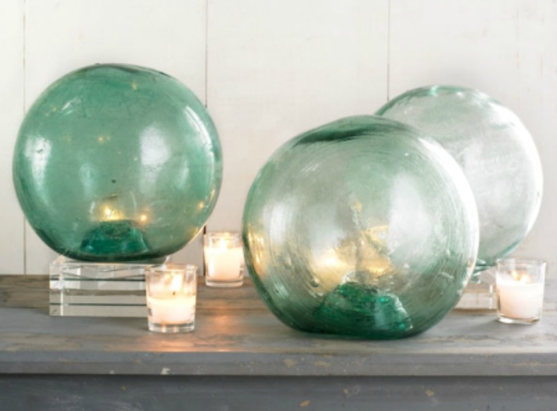 Sea glass balls with candles